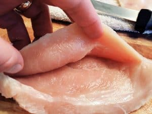 Chicken Cordon Bleu cutting slit to create pouch for ham and cheese.