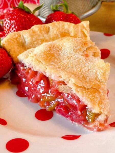 Close up photo of a slice of Strawberry Rhubarb Pie