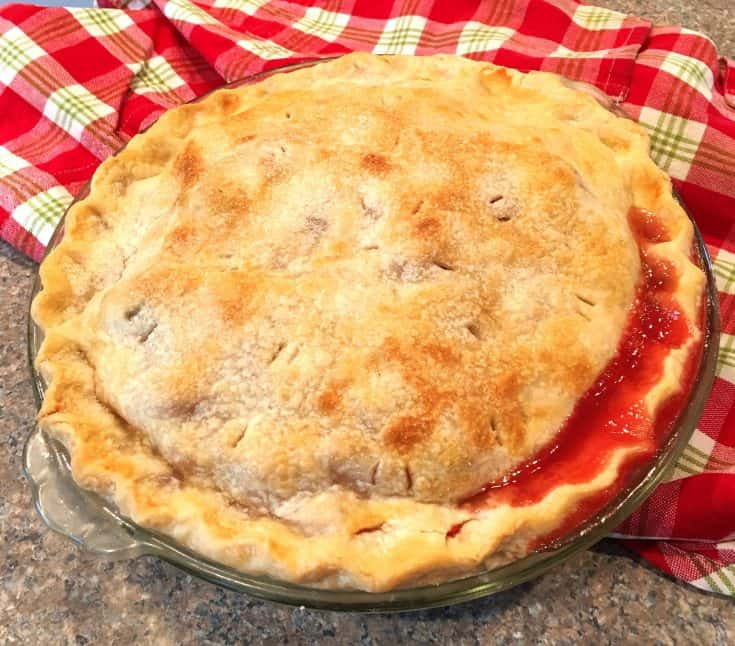 This is the World's BEST Strawberry Rhubarb Pie! It's full of fresh rhubarb and strawberries to give it the perfect combination of tart and sweet. Serve it with a scoop of vanilla ice cream for one of the best homemade country pies you'll ever have! Enjoy!