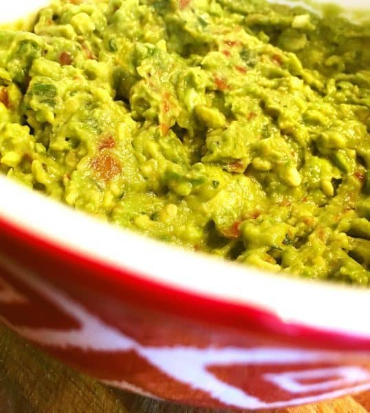 Homemade Guacamole in a beautiful red bowl waiting for chips!