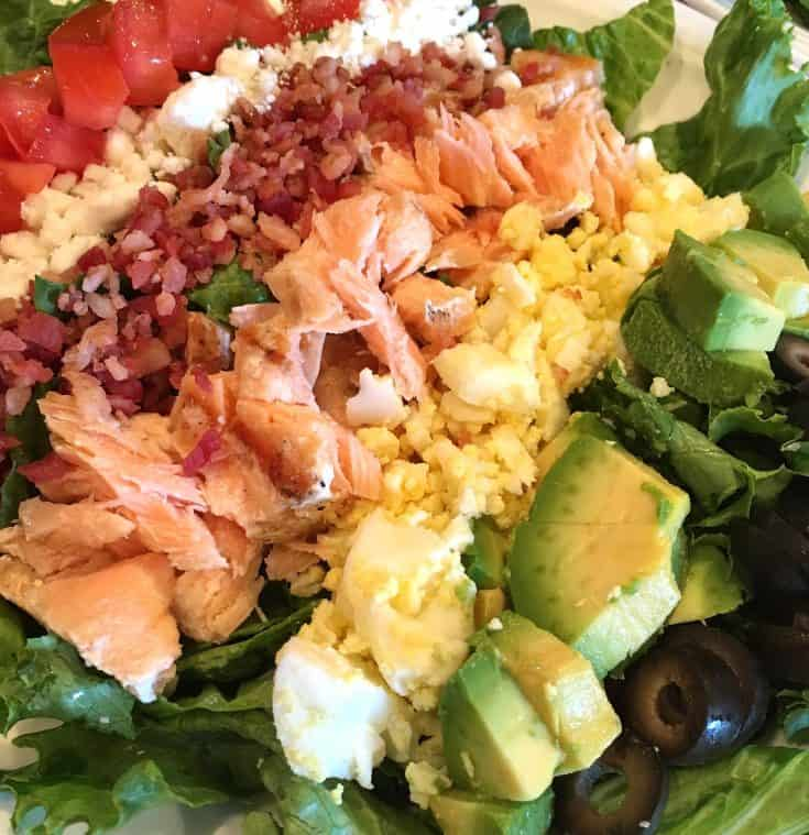 A traditional Cobb Salad with Salmon and Feta Cheese. Fresh, flavorful, and the perfect summertime meal!