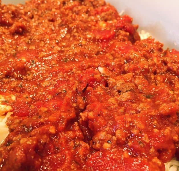 Adding a layer of meat sauce for eggplant parmigiana