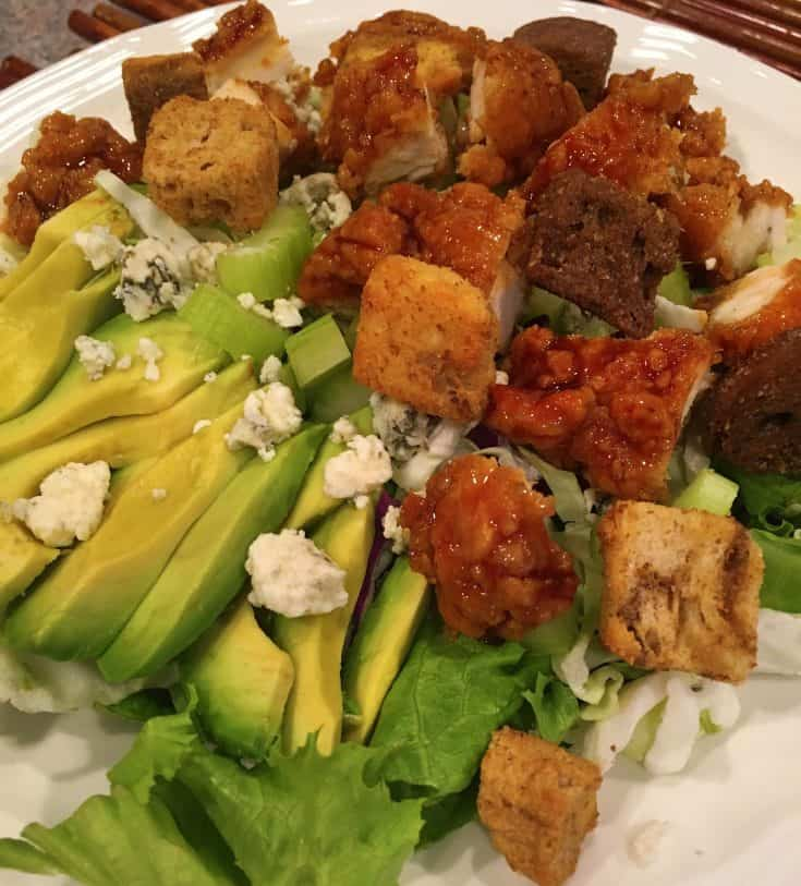 This is a great summertime salad that is a meal by itself! Filled with fresh greens, celery, blue cheese, avocado, and the star of the show...the sticky buffalo strips, it's a mouthwatering delicious salad even the men in your family will like!