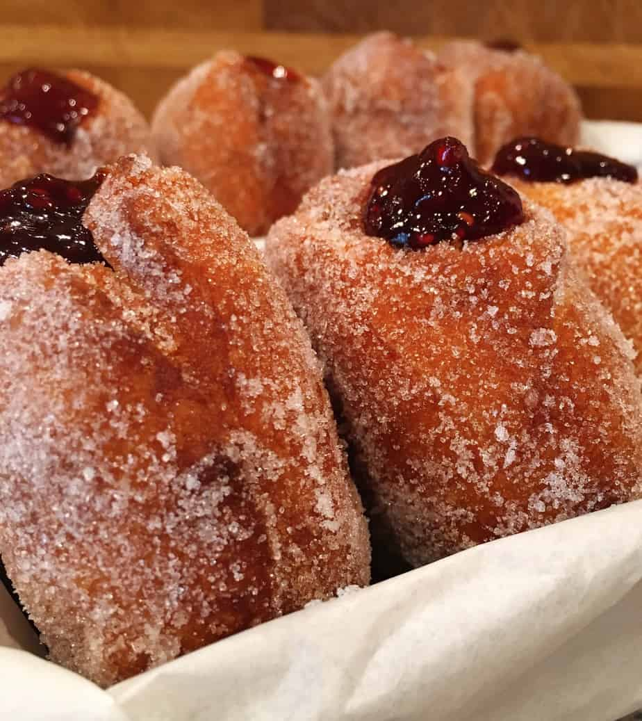 Donuts with a berry filling on a plate