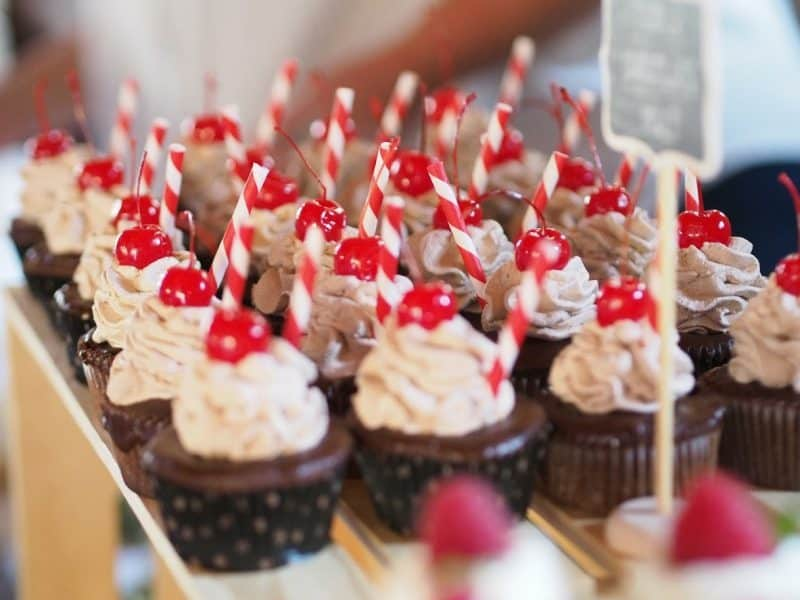 Chocolate cupcakes with a delicious frosting and a cherry on top
