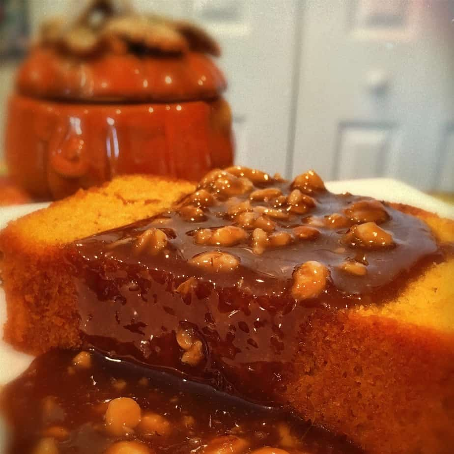 A pumpkin pound cake with a chocolate walnut sauce poured over it
