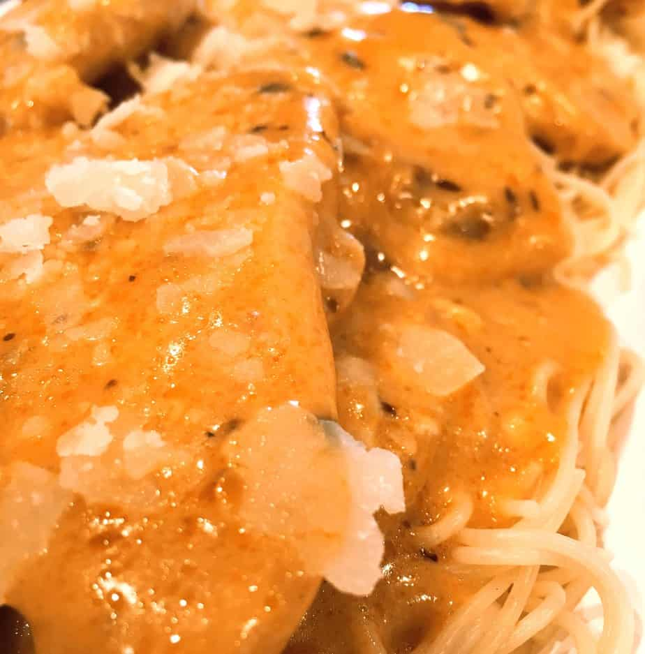 Chicken pieces with angel hair pasta in a light sauce