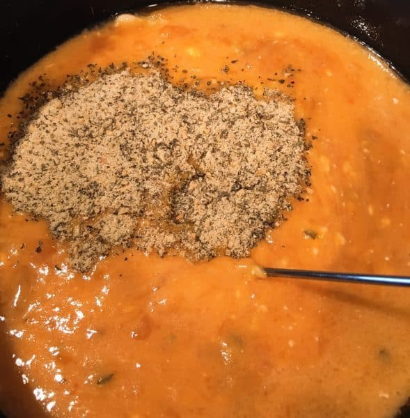 addition of seasonings and spices to soup mixture in slow cooker