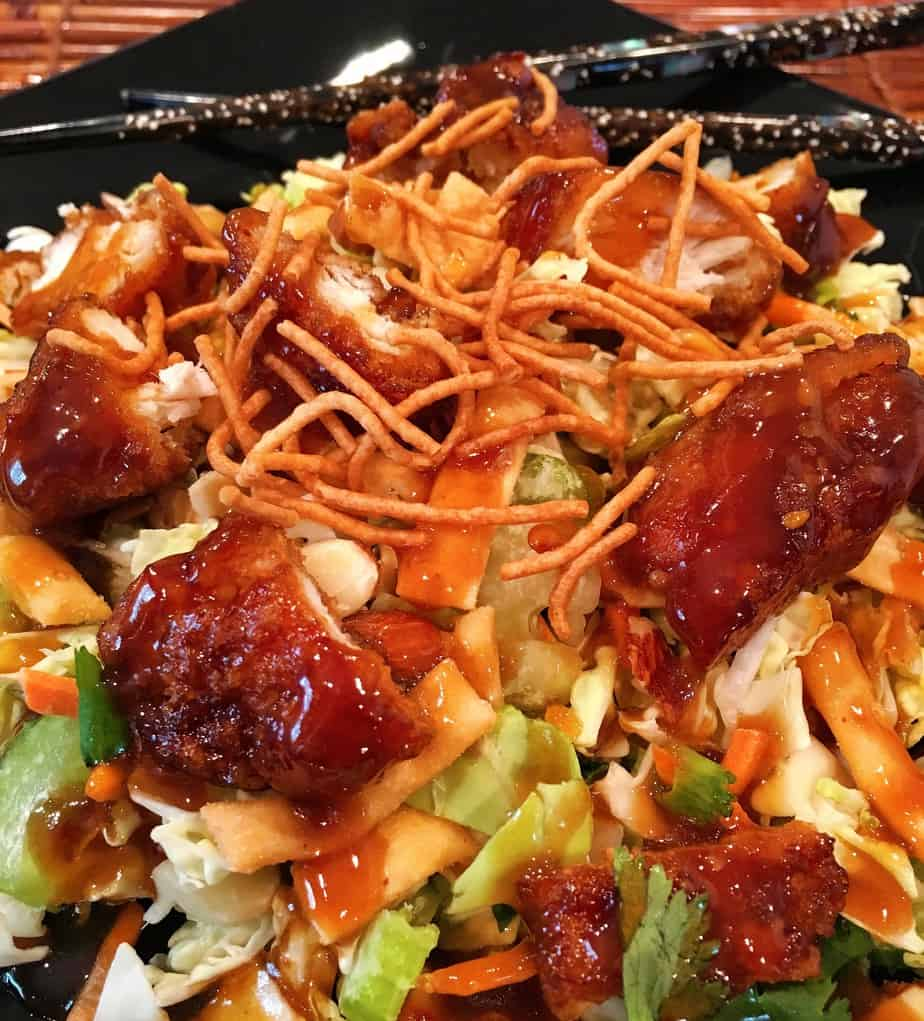 Salad with chicken, vegetables, dried noodles, and an asian sauce