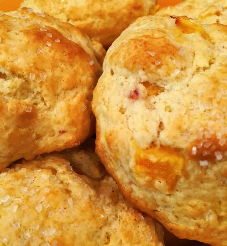 Fresh Peaches and Cream Scones are a light, fluffy, golden brown scone that melts in your mouth! Packed with fresh peaches in every bite!