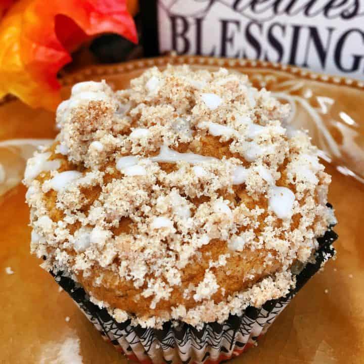 Pumpkin Struesel Muffins on a plate with fall decor.