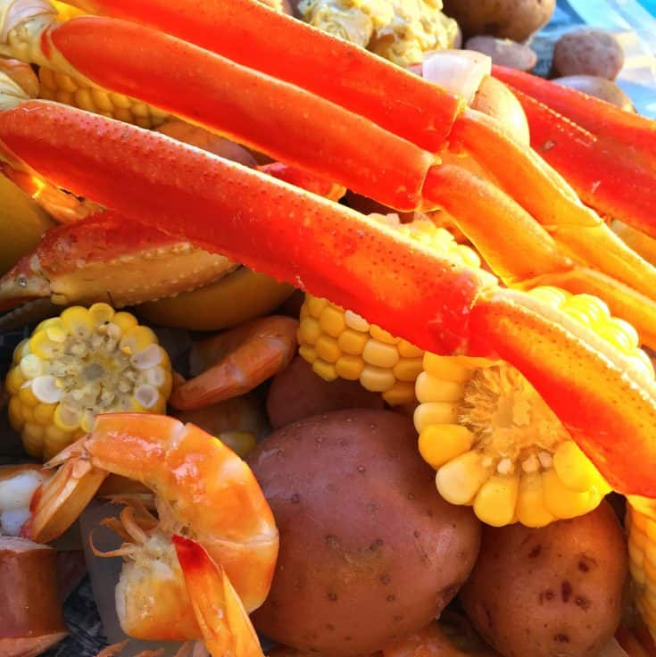 smaller version of a delicious mouth-watering Seafood Boil made wAith Shrimp and Crab. This recipe will serve 4 adults. This is the perfect end of summer meal or perfect for a party at the beach!