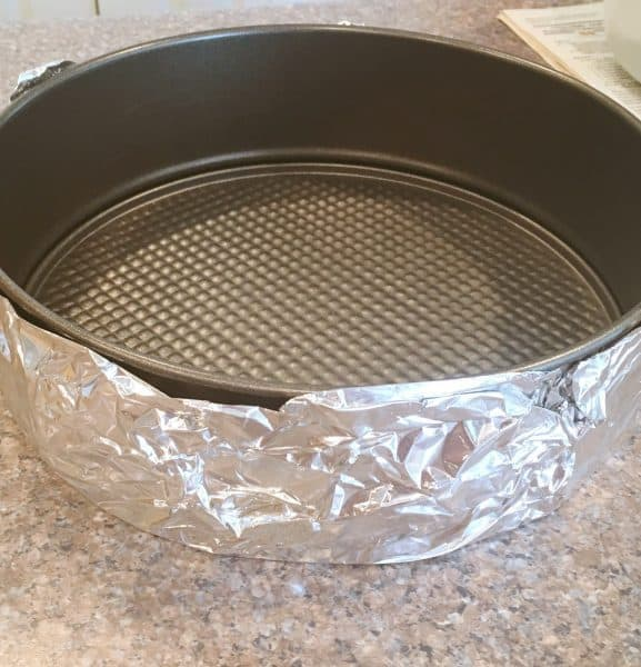 spring form pan wrapped in foil for water bath