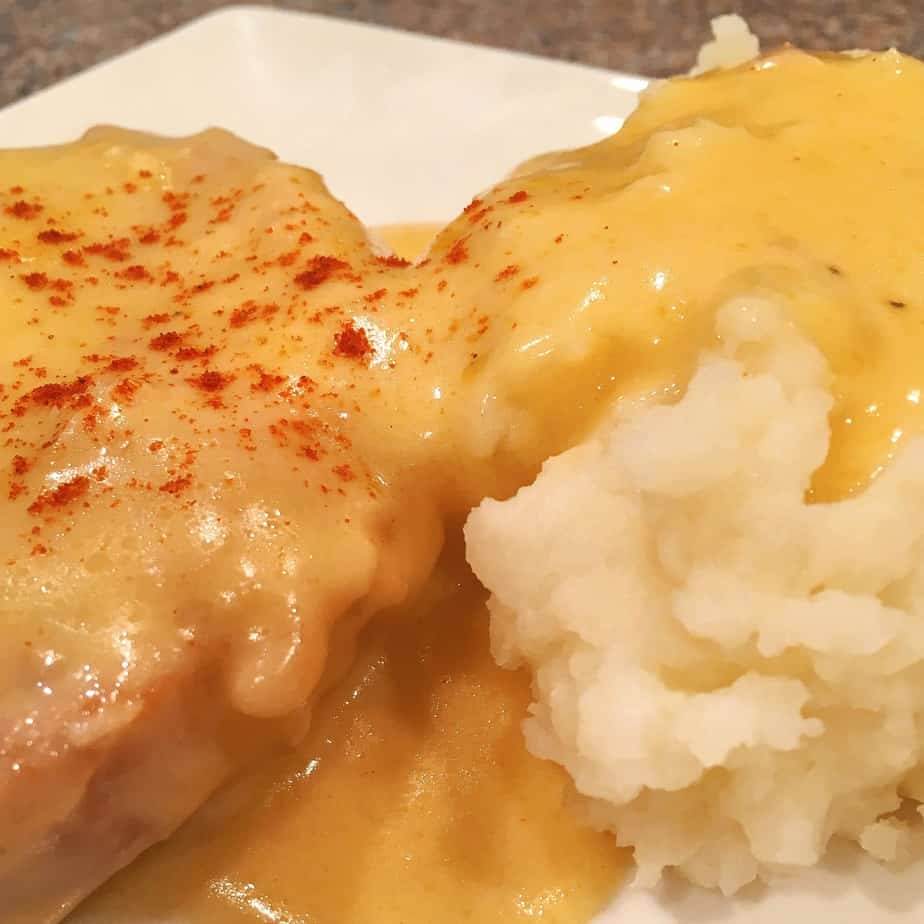 Pork chops cooked in a crock pot and chicken fried with gravy