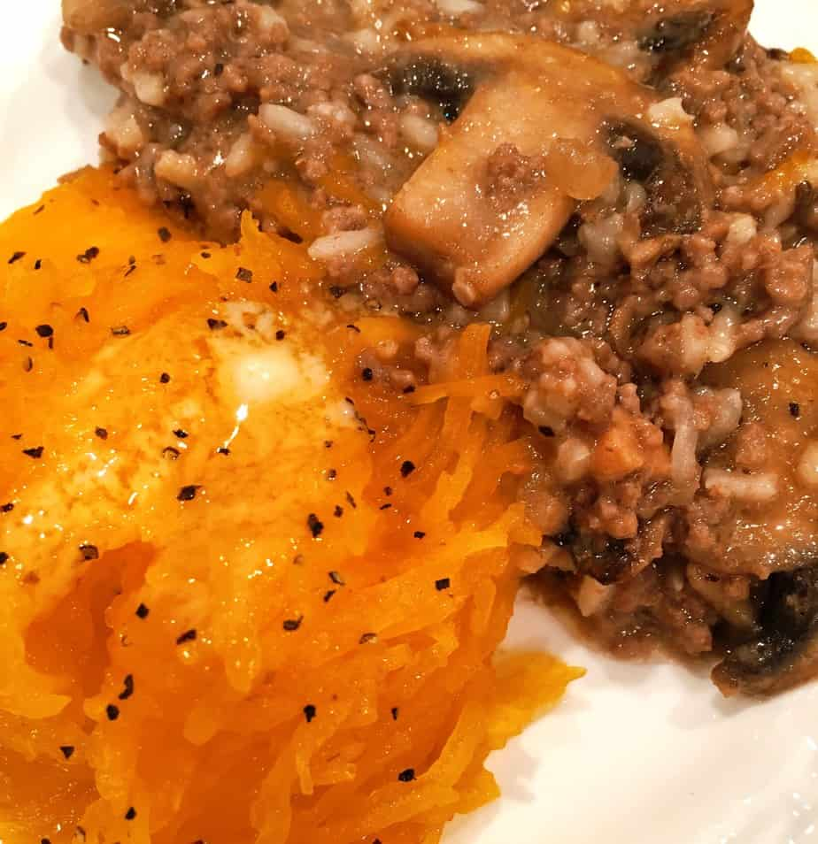 A pumpkin filled with ground beef, seasonings and rice