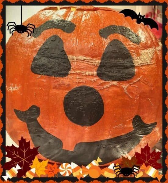 Big baked stuffed pumpkin with jack-o-latternface for dinner in a pumpkin