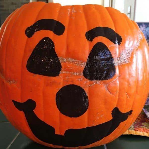 Face painted on pumpkin for dinner in a pumpkin