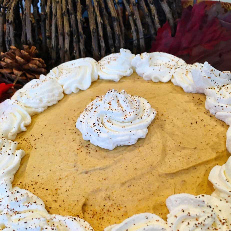 A chiffon pie made with pumpkin and whip cream
