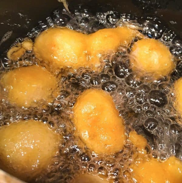 sweet and sour chicken frying in hot oil