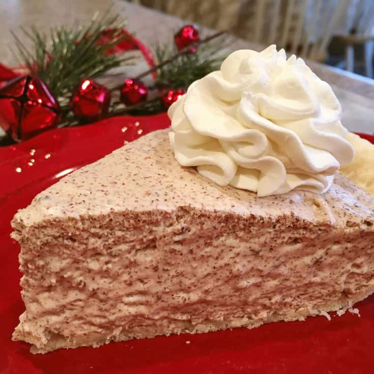 A fluffy creamy dreamy chiffon pie that is like a rich chocolate chip mousse piled high in a flaky crust and served with a dollop of whip cream. Perfect for the Holidays and sure to become a family favorite!