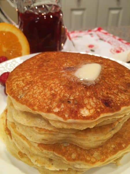 Stack of Cranberry Orange Pancakes with butter