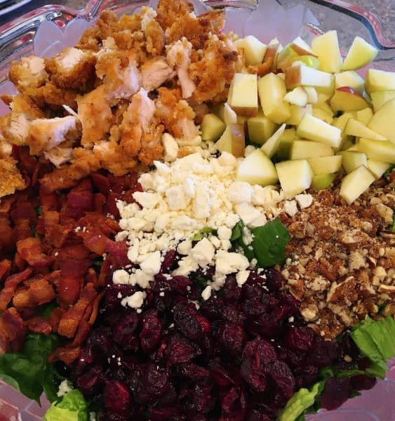 Chopped Autumn Harvest Salad with chicken, apples, candied pecans, feta cheese, bacon, and cranberries