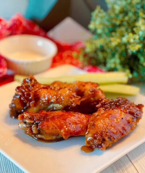 Copy Cat Winger Wings on a plate with celery