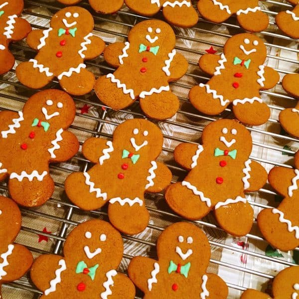 Spiced Gingerbread men on cooling rack decorated with royal icing