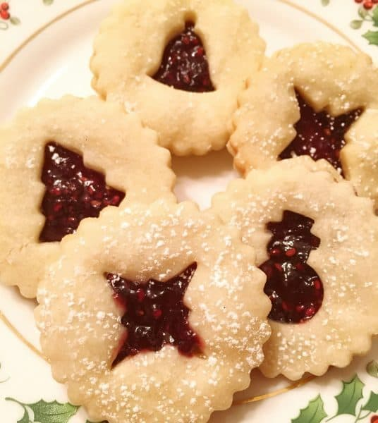 Linzer Cookies on Christmas plate ready for eating