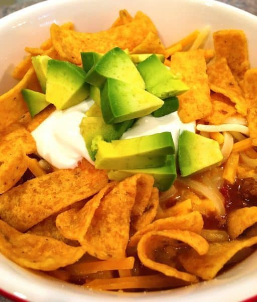 taco soup with fritos, avocado, and sour cream