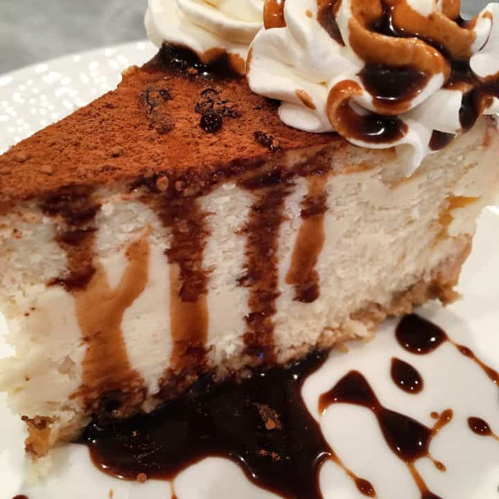 Tiramisu Cheesecake with Kahlua Chocolate Syrup on a plate