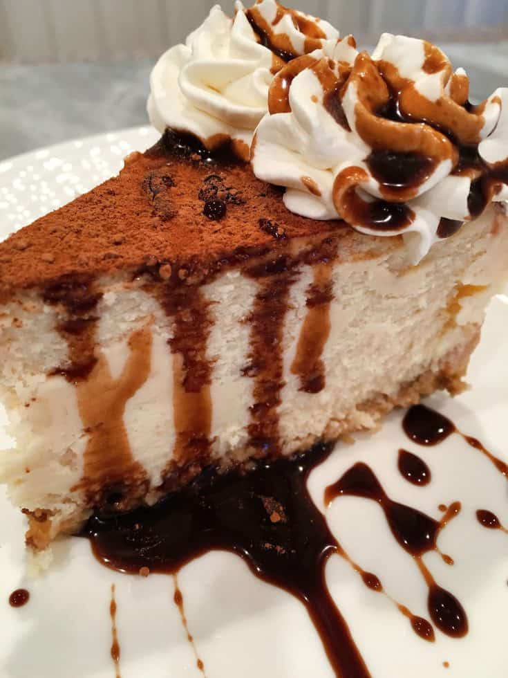 An elegant creamy rich cheesecake with hints of coffee and chocolate flavoring make this the perfect Holiday cheesecake! As good as any dessert at your favorite 5 star restaurant!