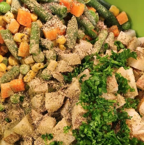 Spices and herbs added to chicken and vegetables for pot pie