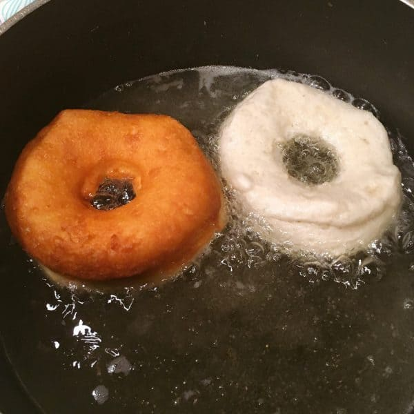 Grand Biscuit Donuts frying in hot oil