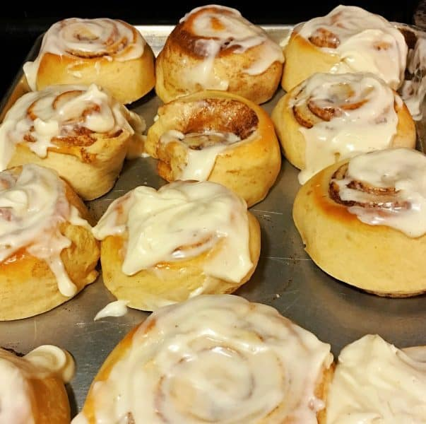 delicious cinnamon rolls with a golden crest and cream cheese frosting