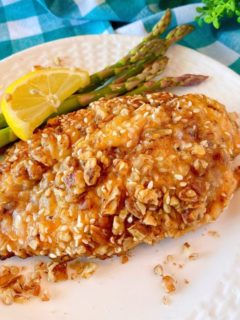 Pecan Chicken on a plate with asparagus