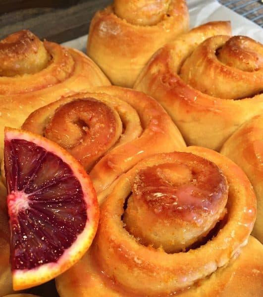 Orange Rolls in a baking dish with Blood Orange Glaze