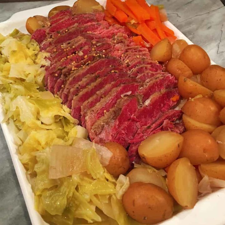 Platter full of corned beef, cabbage, potatoes and carrots