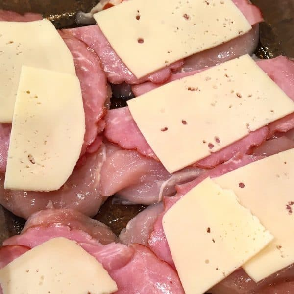 Ham topped with slices of Swiss Cheese