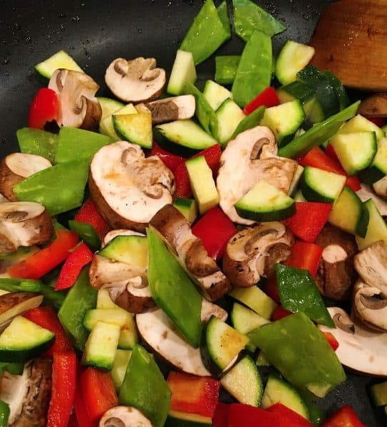 Mixed vegetables stir fry in a wok