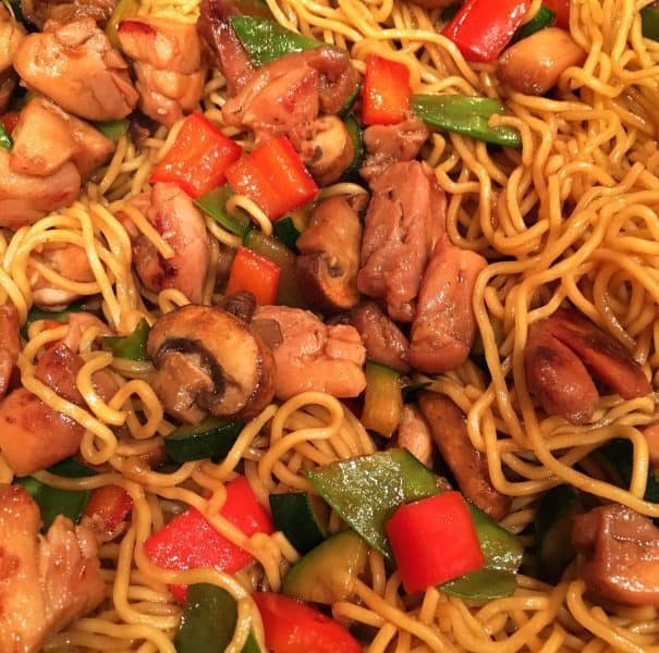 Add noodles in to chicken and stir vegetables
