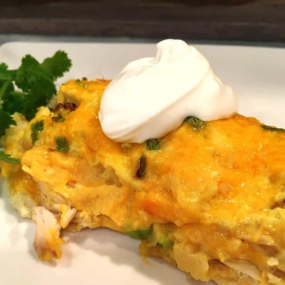 Chicken enchiladas with cheese and sour cream