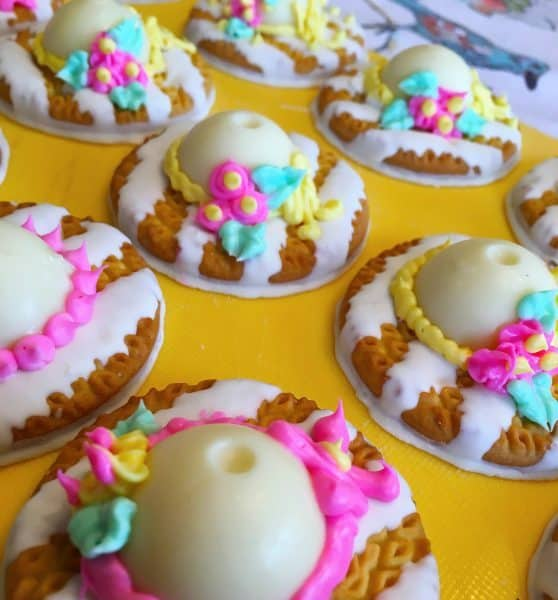 Easter Bonnet Cookies with frosting decor on them
