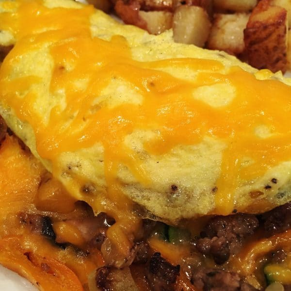 topping omelet with more cheese