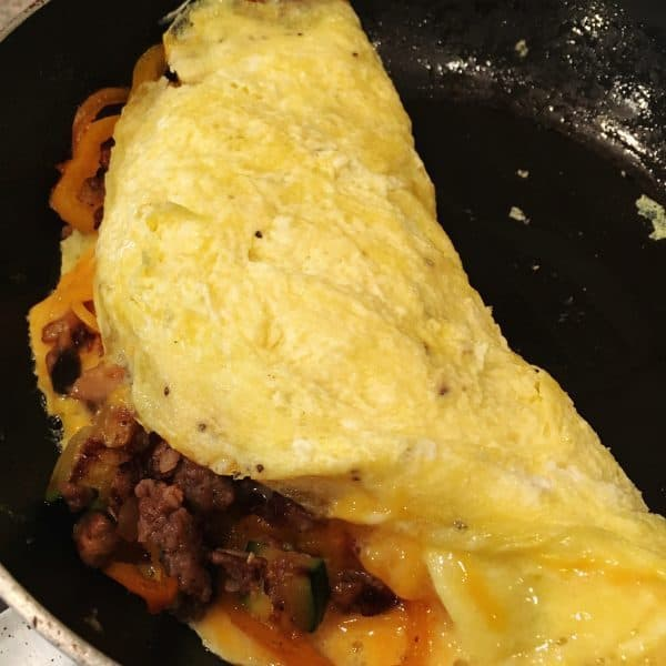 folding omelet over filling