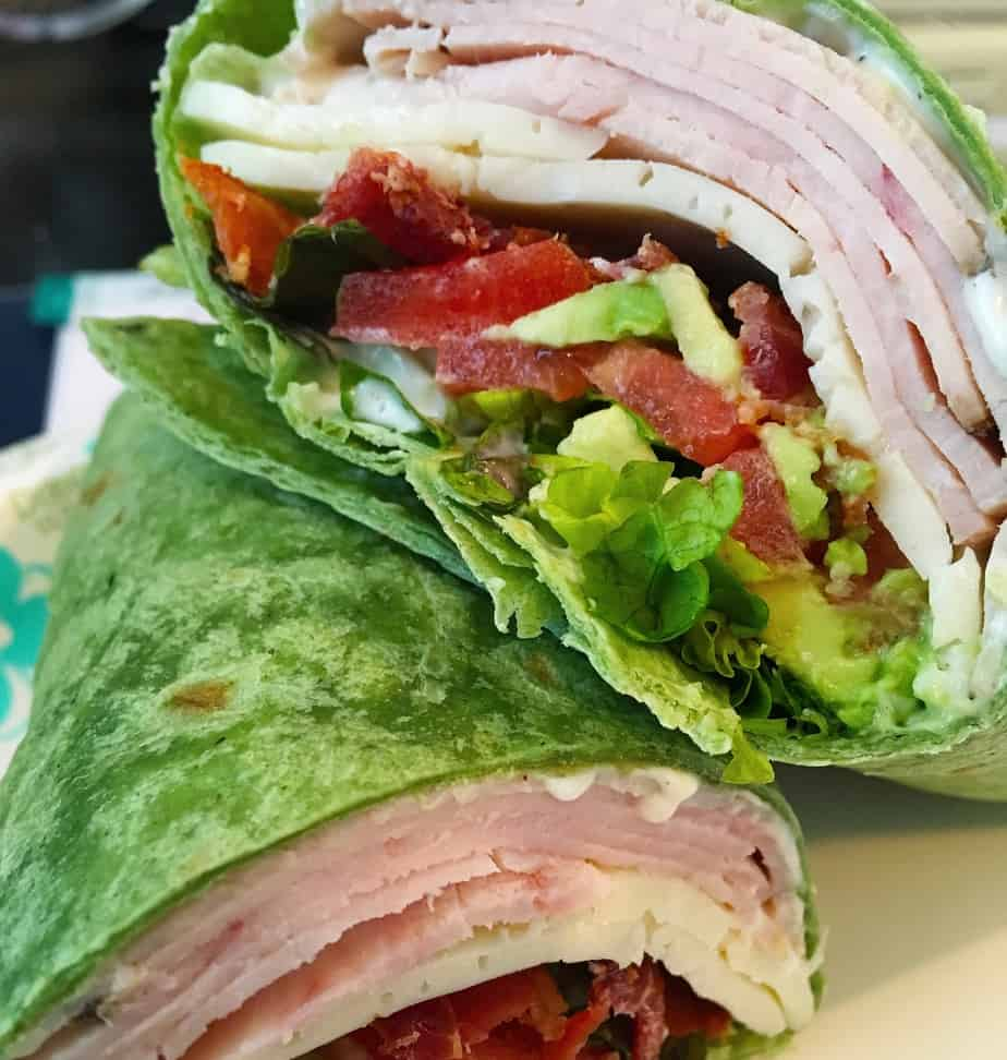 Turkey, tomatoes, cheese, bacon and lettuce wrapped up in a tortilla