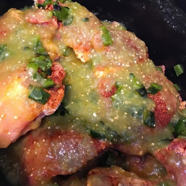 green salsa and peppers on chicken