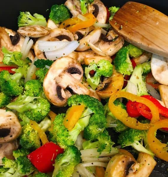 sauteed veggies in a pan for quiche