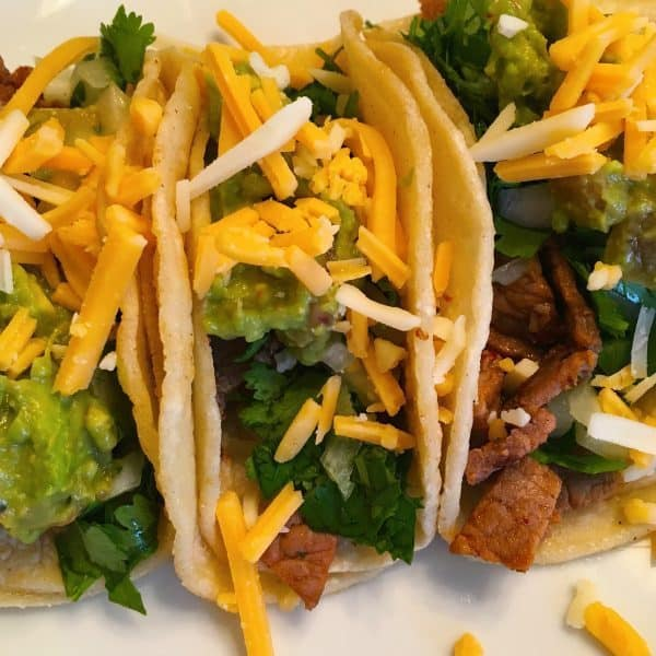street tacos with guacamole and cheese with carne asada