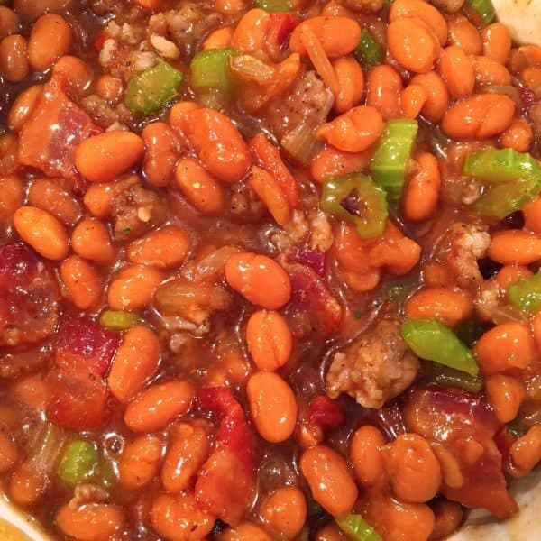 Baked Beans loaded with meat and veggies in a slow cooker